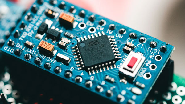 A blue circuit board with computer components