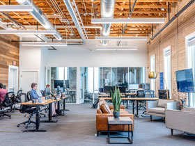 Contemporary Loft Style Office with Employees at Desks