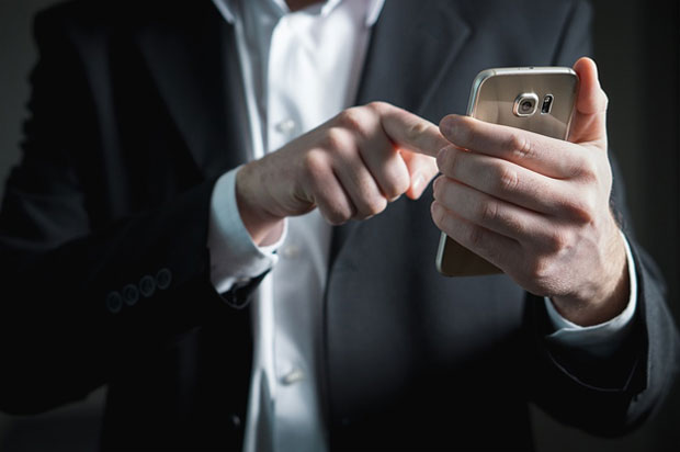Man in suit using phone
